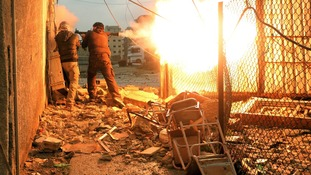 Members of the Free Syrian Army battle against government forces.