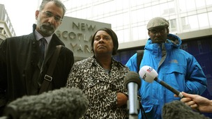 Doreen Lawrence with her son Stuart, and lawyer Imran Khan, talks to the media outside court on June 28.