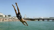 Andrew Smith leaps off the sea wall in Brighton, East Sussex.