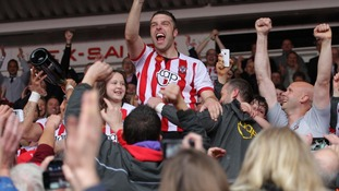 Southampton's Rickie Lambert celebrates with fans at the final whistle following the club's promotion to the Premier League