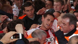 Southampton's Billy Sharp of is helped down the tunnel by stewards at end of game during Football League Championship match
