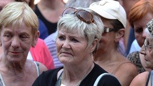 Mourners pay their respects