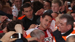 Southampton Billy Sharp of is helped down the tunnel by stewards at the end of the game.