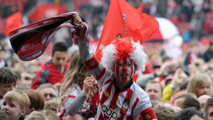 A young Southampton fan celebrates promotion to the Premier League