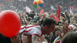 Southampton's Daniel Fox is carried off the pitch by jubilant fans at the end of the game