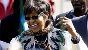 Winnie Madikizela-Mandela greeting wellwishers gathered outside her former husband's hospital.