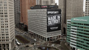 'Opportunity Made In Detroit' banner seen on the side of a building