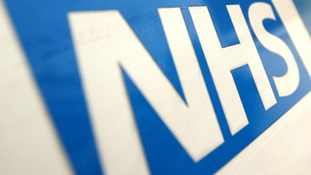 An NHS logo.