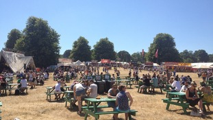 Festival goers enjoying the sunshine at Latitude