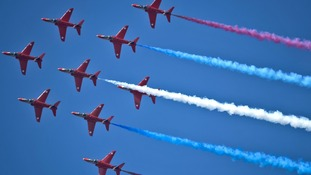 Royal Air Force Red Arrows Display Team perform at RAF Fairford, Wiltshire