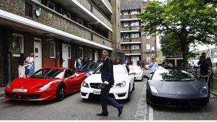 16-year-old Aminul Mishu Alam walks past cars parked in Tower Hamlets