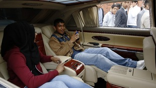 Jannat and Wahid sit in a Maybach