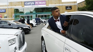Samad Ahmed leans out of a Maybach