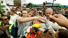 Alexei Navalny is greeted by hundreds of supporters as he arrives in Moscow