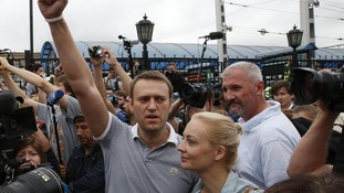 Alexei Navalny with his wife Yulia are greeted by crowds in Moscow
