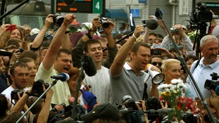 Alexei Navalny speaks to reporters in Moscow after he was released from jail