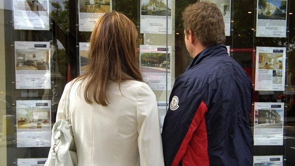 couple at estate agent window
