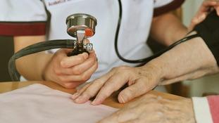 A woman having her blood pressure taken.