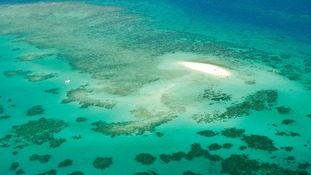 An aerial view of the Great Barrier Reef off the coast of Queensland in Australia.