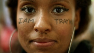 The message 'I am Trayvon' is displayed on the face of Keesha Clark during a march in Los Angeles.