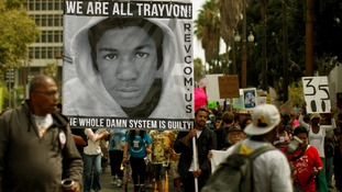 People carry a photo of Trayvon Martin during the Los Angeles march.