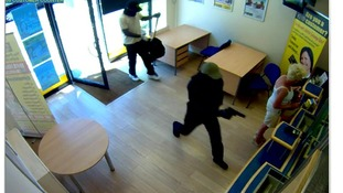 Suspects enter Western Union shop