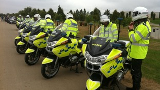 Police motorcyclists arrive at National Memorial Arboretum