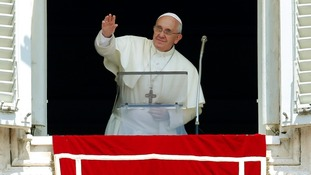 Pope Francis waved as he led prayers in Saint Peter's Square he is due to arrive in Rio today.