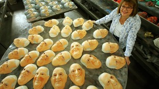 Mask in honor of Pope Francisco, is displayed in a factory in Rio de Janeiro.