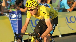Chris Froome rides through Paris during the final stage of the Tour de France.