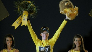 Chris Froome takes to the podium after winning the Tour de France.