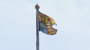The Royal Standard is flying above Buckingham Palace.