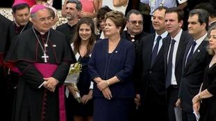 Brazil's president Dilma Rousseff waiting to greet the pontiff on the tarmac of Rio de Janeiro's airport.