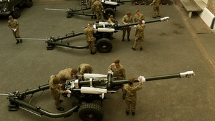 The Honourable Artillery Company (HAC) polish the guns for the Royal Gun Salute from the Tower of London.