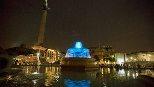 The fountains at Trafalgar Square are seen lit blue to signify the birth of a baby boy.