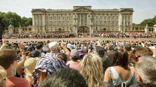 Members of the public are pictured outside Buckingham Palace ahead of the arrival of the Royal baby.