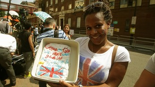 Teba Diatta holds a cake outside the Lindo Wing of St Mary's Hospital.