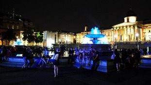 Well-wishers gather around the fountains in Trafalgar Square.