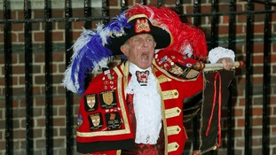 Town Crier Tony Appleton outside the St Mary's Hospital in London announcing the birth of a baby boy.