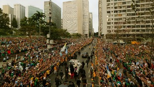 Crowds greet Pope Francis in downtown Rio de Janeiro.