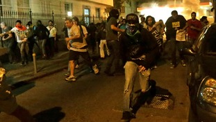 Demonstrators run from police during clashes near Guanabara Palace where Pope Francis was meeting with President Dilma Rousseff.