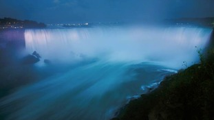 Niagara Falls has been lit blue to mark the royal birth.