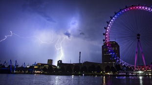 The lightning struck early this morning as the London Eye was coloured red, white and blue to mark the royal baby's birth.
