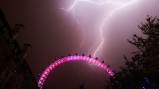 Lightning strikes behind the London Eye in central London.