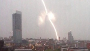 A lightning strike hits near Manchester Piccadilly station this morning.