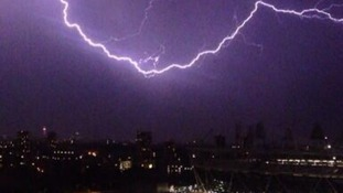 Lightning strikes over the Olympic Stadium.
