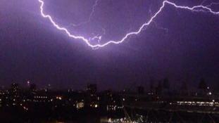 Lightning strikes over the Olympic Stadium.