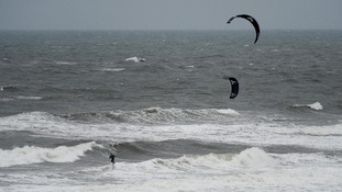 A kite surfer enjoys the strong winds on Tynemouth Beach, Tyne and Wear.