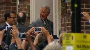 Prince Charles surrounded by cameras as he enters hospital.