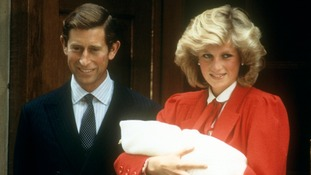 Prince Charles and Princess Diana introduce Prince Harry to the world.